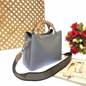 Дизайнерская сумочка Telyviv с широким ремнем через плечо из матовой эко-кожи цвета нежно-серого.