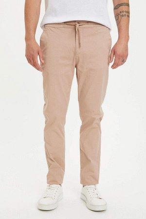 брюки Размеры модели: рост: 1,82 грудь: 98 талия: 81 бедра: 96 Надет размер: размер 32 - рост 32  Хлопок 97%,Elastan 3%