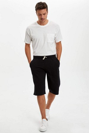 шорты Размеры модели: рост: 1,89 грудь: 100 талия: 81 бедра: 97 Надет размер: M  Полиэстер 30%, Хлопок 70%
