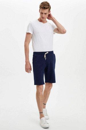 шорты Размеры модели: рост: 1,88 грудь: 98 талия: 82 бедра: 95 Надет размер: M  Хлопок 47%,Di?er Elyaf 3%, Полиэстер 50%