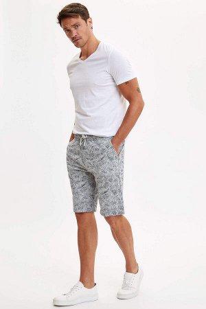 шорты Размеры модели: рост: 1,89 грудь: 100 талия: 81 бедра: 97 Надет размер: M  Полиэстер 40%, Хлопок 60%