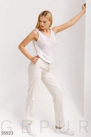Льняные бежевые брюки свободного кроя