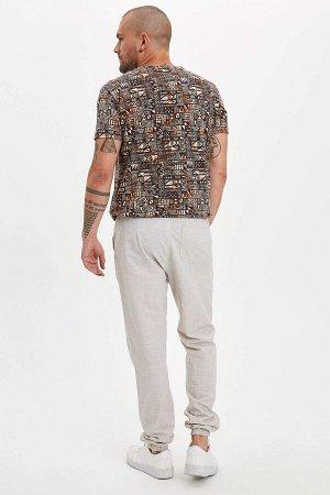 брюки Размеры модели: рост: 1,82 грудь: 98 талия: 81 бедра: 96 Надет размер: 32  Хлопок 100%