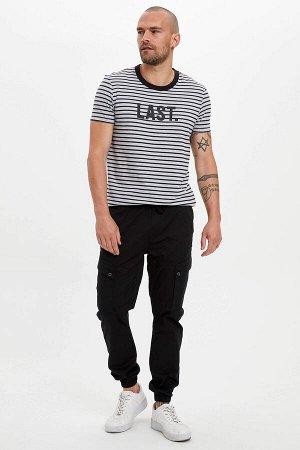брюки Размеры модели: рост: 1,82 грудь: 98 талия: 81 бедра: 96 Надет размер: 30 Elastan 2%, Хлопок 98%