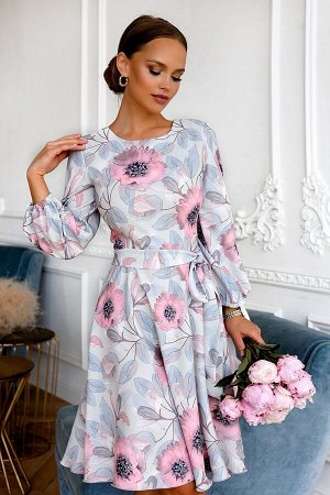 Платье Размер: 42 Новинка! Носим в этом летнем сезоне очень модый цветочный принт! Нежный цвет ткани освежит Ваш образ! Отрезное по линии таиии с пояском, акцент уделяется вточными рукавами на сборке
