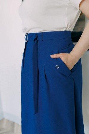 Юбка миди Лен-55%, вискоза -45%, Рост: 164 см. Юбка трапецивидного силуэта без подкладки. Верх обработан притачным поясом. По переднему и заднему полотнищам юбки кокетка, от кокетки заложены складки.