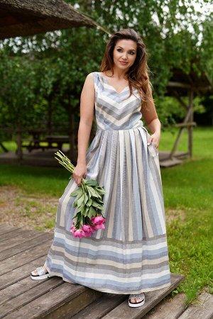 Сарафан 70% вискоза 30% лён Рост: 164 см. Великолепное летнее платье-сарафан, полуприлегающего силуэта, расклешеное книзу. Лиф на подкладке. Горловина с V-образным вырезом, на бретелях. Платье отрезно