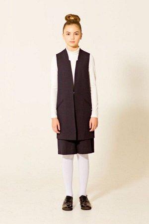 Жилет 2.71 (серый) Для девочек среднего школьного возраста.  Удлиненный жилет полуприлегающего силуэта, однобортный,с отрезными бочками, со скошенной вверху линией борта и воротником стойка. Без застё