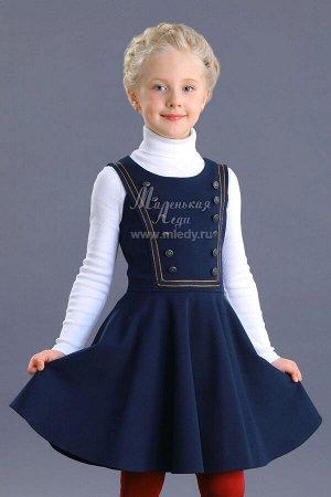 Сарафан Ткань: Трикотаж костюмный Состав: 65%вискоза, 32%полиамид, 3%эластан Сарафан в морском стиле для девочки. Лиф выполнен в виде отложного матросского воротничка с настроченной репсовой лентой