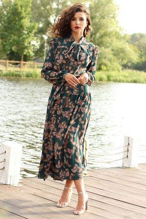 Платье Платье Мода Юрс 2507 морская волна/цветы  Состав ткани: ПЭ-100%;  Рост: 170 см.  Платье, которое станет любимым в Вашем гардеробе. Стильный фасон, актуальный принт. По переду и спинке с отрезн