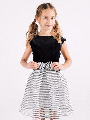 Платье ткань 1 - Хлопок 100%, ткань 2 - ПЭ 100%. Нарядное платье из хлопкового бархата чёрного цвета без рукавов. Модель украшена бантом по центру талии и застёгивается на спинке при помощи застёжки м