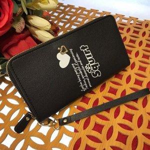 Полноразмерный женский кошелек Squirt из матовой эко-кожи черного цвета.