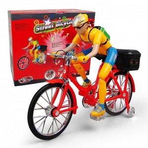Игрушка музыкальный Велосипед с велосипедистом
