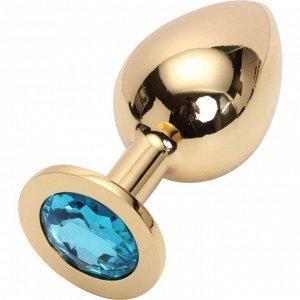 Большая тяжелая золотая металлическая пробка с голубым кристаллом