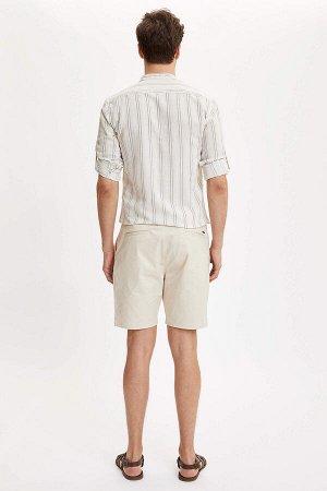 шорты Размеры модели: рост: 1,86 грудь: 97 талия: 74 бедра: 96 Надет размер: 32  Хлопок 98%,Elastan 2%