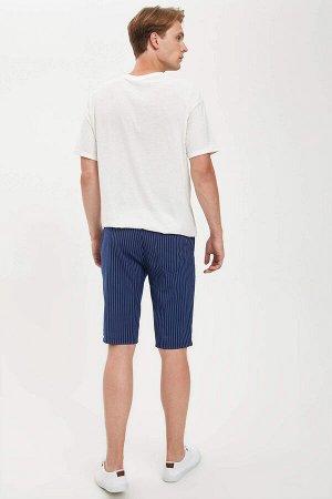 шорты Размеры модели: рост: 1,89 грудь: 98 талия: 76 бедра: 96 Надет размер: 30  Вискоз 34%, Полиэстер 64%,Elastan 2%