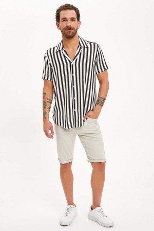 рубашка Размеры модели: рост: 1,83 грудь: 98 талия: 82 бедра: 96 Надет размер: L  Вискоз 100%