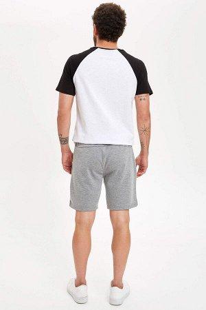шорты Размеры модели: рост: 1,83 грудь: 98 талия: 82 бедра: 96 Надет размер: M  Полиэстер 55%, Хлопок 45%