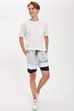 шорты Размеры модели: рост: 1,89 грудь: 98 талия: 76 бедра: 96 Надет размер: M  Полиэстер 50%, Хлопок 50%