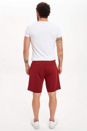 шорты Размеры модели: рост: 1,83 грудь: 98 талия: 82 бедра: 96 Надет размер: M  Полиэстер 66%, Вискоз 14%, Хлопок 20%