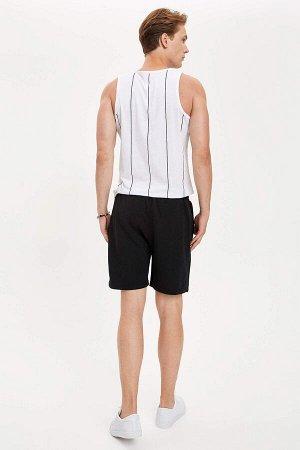 шорты Размеры модели: рост: 1,89 грудь: 98 талия: 76 бедра: 96 Надет размер: L  Полиэстер 50%, Хлопок 50%