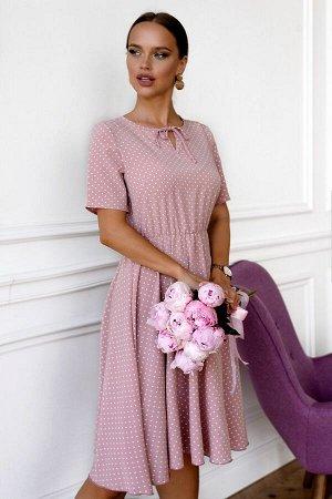 Платье Размер: 44 / 46 Яркий насыщенный принт не оставит никого равнодушным. Платье с V--образным вырезом с затекой до талии и расклешенной юбкой. Этот наряд смотрится очень эффектно. Добавит яркости