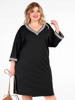 """Платье Оригинальное демисезонное платье прямого силуэта, с рукавом покроя - кимоно, длиной за локоть. Горловина в форме """"лодочка"""". Полочка поделена геометрическими вставками из отделочной ткани двух ц"""