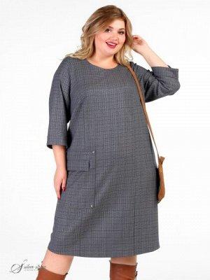 Платье Оригинальное демисезонное платье прямого силуэта. Рукав втачной, длиной 3/4. Модель выполнена из смесовой ткани с содержанием эластана. В среднем шве спинки обработана шлица. На правой стороне