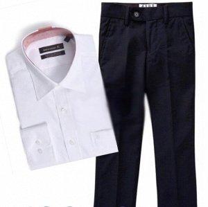 Костюм Костюм классического покроя, однотонная рубашка белой расцветки с коротким рукавом. Важно! Для сохранения презентабельного облика одежды необходимо гладить ее с изнаночной стороны. Это поможет