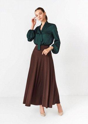 Юбка Юбка Alina Assi выполнена из стрейчевого трикотажа. Модель расклешенного кроя. Детали: широкий эластичный пояс, без подкладки.