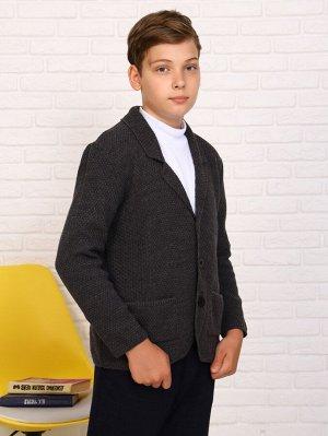 Кардиган Характеристики: Состав- акрил Теплый и удобный кардиган для мальчика. Прекрасно подойдет для школы. Можно носить, как срубашкой, так и с футболкой под низ.
