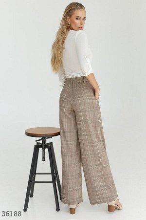 Трендовые клетчатые брюки палаццо