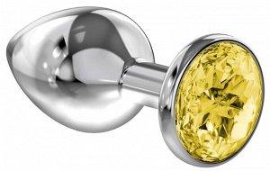 Большая серебряная металлическая пробка с желтым кристаллом
