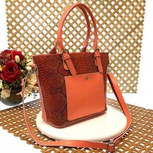 Женская сумочка Estate из натуральной кожи кораллового цвета.
