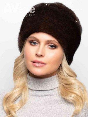 Шапка Роскошная женская зимняя норковая шапка мягкой формы. Оригинальные буфы в верхней части изделия создают интересную фактуру и силуэт головного убора, а ручная вышивка хрустальными бусинами выгодн