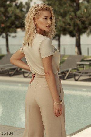 Бежевые брюки-палаццо