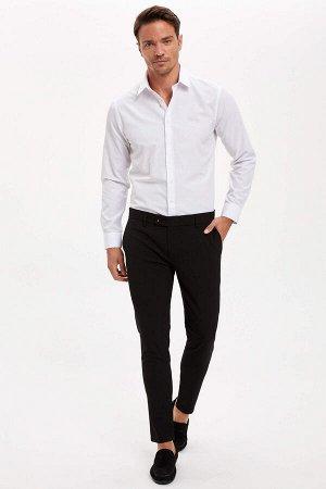 брюки Размеры модели: рост: 1,89 грудь: 100 талия: 81 бедра: 97 Надет размер: 34 Elastan 3%, Вискоз 32%, Полиэстер 65%