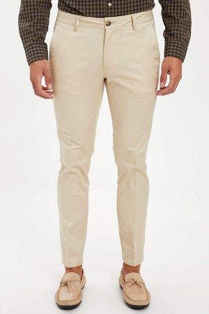 брюки Размеры модели: рост: 1,89 грудь: 100 талия: 81 бедра: 97 Надет размер: размер 32 - рост 30 Elastan 2%, Хлопок 98%