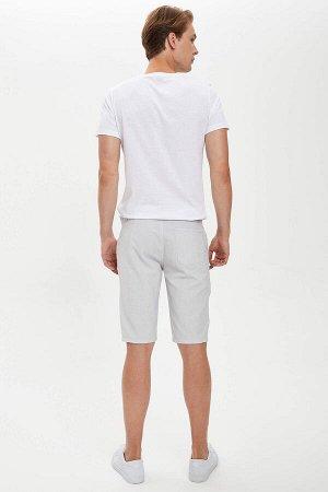 шорты Размеры модели: рост: 1,89 грудь: 98 талия: 76 бедра: 96 Надет размер: 30 Elastan 2%, Вискоз 24%, Полиэстер 74%