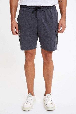 шорты Размеры модели: рост: 1,89 грудь: 100 талия: 81 бедра: 97 Надет размер: M  Полиэстер 45%, Хлопок 55%