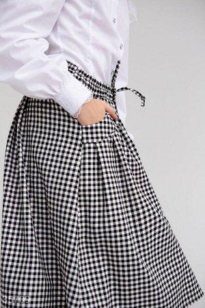 Расклешенная юбка в классическую клетку