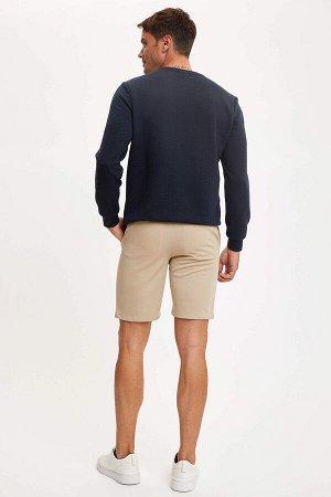 шорты Размеры модели: рост: 1,89 грудь: 100 талия: 81 бедра: 97 Надет размер: 30  Полиэстер 100%