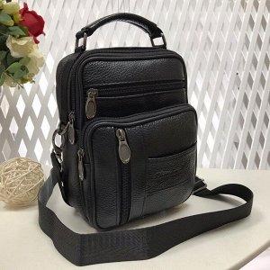 Мужская сумка Onix из мягкой натуральной кожи с ремнем через плечо чёрного цвета.