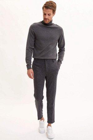 брюки Размеры модели: рост: 1,88 грудь: 96 талия: 77 бедра: 96 Надет размер: размер 32 - рост 30  Вискоз 24%, Полиэстер 72%,Elastan 4%