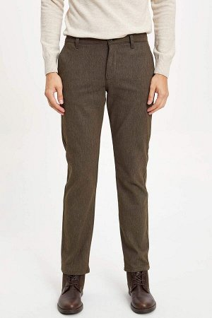 брюки Размеры модели: рост: 1,89 грудь: 99 талия: 75 бедра: 99 Надет размер: размер 30 - рост 32 Elastan 1%, Полиэстер 32%, Хлопок 67%