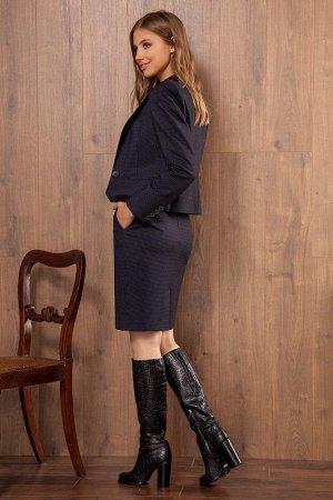 Юбка миди Рост: 170 см. Состав ткани: полиэстер 70%, вискоза 25%, спандекс 5% Классическая юбка из плотного трикотажа с мелким дизайном в клетку, зауженная к низу. Юбка на притачном поясе с боковыми н