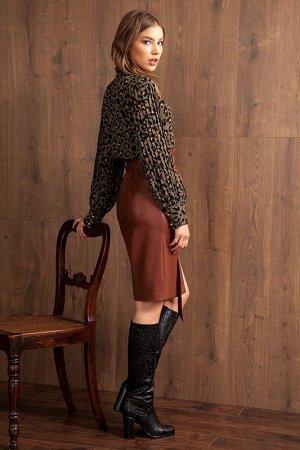 Юбка миди Рост: 170 см. Состав ткани: вискоза 82,8%, полиэстер 17,2%, покрытие - полиуретан 100% Юбка из экокожи прямого силуэта, длиной выше колена. Талия завышенная с поясом на резинке и цельнокроен