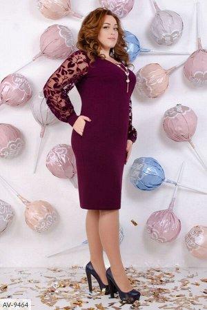 Платье платье приталенное , с оригинальным вырезом, рукава из евросетки с манжетами.