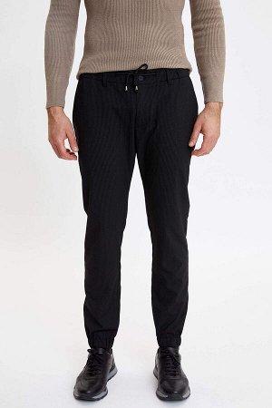 брюки Размеры модели: рост: 1,88 грудь: 104 талия: 76 бедра: 96 Надет размер: размер 32 - рост 30 Elastan 3%, Вискоз 34%, Полиэстер 63%