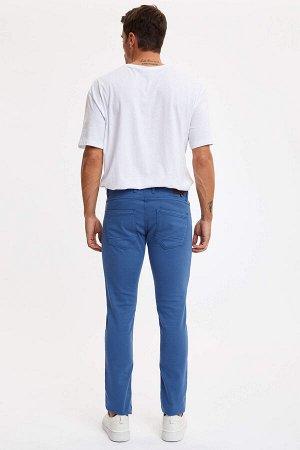 брюки Размеры модели: рост: 1,89 грудь: 100 талия: 81 бедра: 97 Надет размер: размер 32 - рост 32  Хлопок 61%,Elastan 2%, Полиэстер 37%
